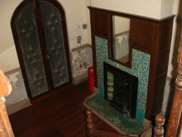 Tiled fireplace in a downstairs room in Windybrow