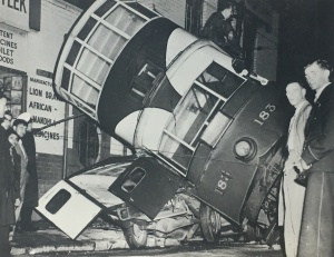 Overturned tram in the city c1930s