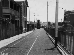 The Post office is on the right and Grand Station behind the vehicle on the tracks