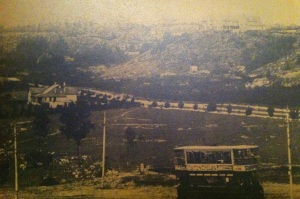 Tram going up Jan Smuts with underdeveloped Valley Road in the background