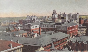 Early aerial view of the Standard Theatre showing the Rissik Street Post office behind