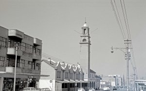 Original Fire Station and tower in the late 1960s looking west down Commissioner Street