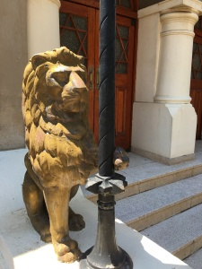 One of the gold lions outside the entrance