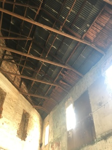 Some of the old wooden ceiling showing